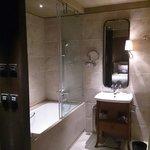 Both shower and bath, nice and spacious.