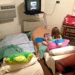 Two kid futons crowded into the room  (