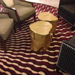 I love these re-purposed stump coffee tables!