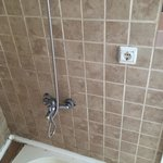 Electric plug socket in shower, why?