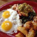 Special shrimp tostada with greens, tomatillo , black beans & eggs