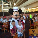 Mickey poses with the kids at Chef Mickeys