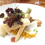 Pork belly with chanterelle, parsnip, corn and rhubarb.