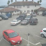 View from the room, parking lot not ocean front as guaranteed.