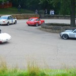 MGB GT, BMW 2002, Austin Healey, and Porsche 914.