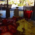 Enjoying a poolside breakfast in the shade.