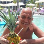 In the pool with a drink in a pineapple!