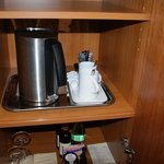 Kettle and complimentary coffe and tea in room.