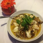 Steamed seabass with pak choi and chinese mushrooms