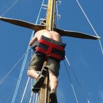 climbing the 60 ft mast (roped in for safety)