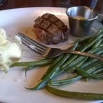 small filet mignon with mashed potato and green beans
