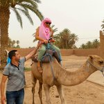Rachid helping me onto my camel!