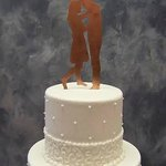 Laura even took care of positioning the custom copper silhouette topper that we ordered from Ets