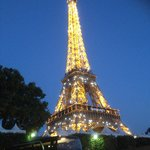 Eiffel Tower light show at 10pm-bus in foreground