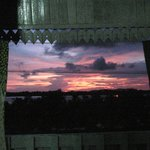 Sunset framed by the opened shutters