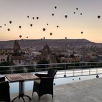Enjoying the balloons early morning with a cappuccino on the terrace