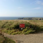 Warning sign heading to the Bedruthan steps