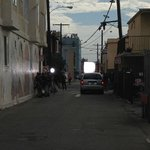 standing in the alleyway looking to the right. Film being made
