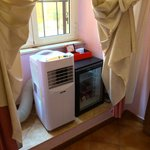 The air cooler and mini bar.