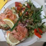 Smoked salmon open sandwich with tomato salsa & hern salad