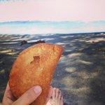 Hand pie on the beach.