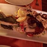 Seafood platter for 2 - 3 fish, 2 skewers and octopus on a bed of seafood risotto. Very tasty!!