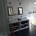 The cute bathroom, with sky light for bath and a nice shower