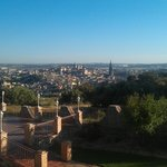 Вид на город с балкона номера. Терраса внизу.
