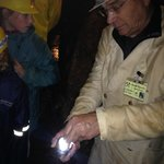 Our guide shows the group some mineral rocks