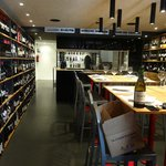 The upstairs dining room and wine bar, including bottles you can take away