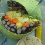 Black bean and avocado wrap with smashed potatoes