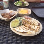 Veggie quesadilla, side of BBQ pulled pork, veggie chili plate, and corn bread