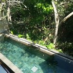 View of private pool from lounge upstairs
