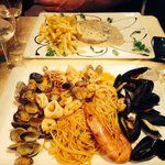 Sea food pasta and steak with cream sauce