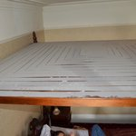 Dust on top of roof of 4 poster bed in room 133