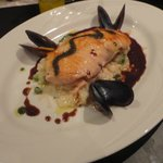 The Grilled Salmon served on a bed of Pea & Shrimp Risotto with Mussels on the side
