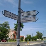 Signpost that guides you to the factory from nearby bus/tram station