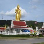 Huge standing golden Buddha