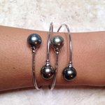 White gold bracelet with black pearls.