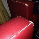 Sofas in bar area. Very worn.
