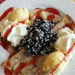 Pancakes with hot blueberries and vanilla ice cream