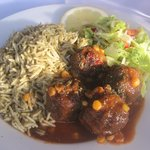 Kofta Chalaw (Afghan meatballs in plum sauce) with spinach rice