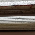 Filthy dirt, hair, and carpet fibers in sliding door rails