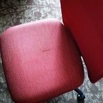 This is the condition in which I found the desk chair when I checked in.  Guest services replace