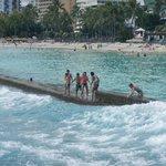 Playing in the waves on Waikiki