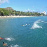Surfing on Waikiki with Diamond Head in the background