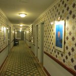 Check out the corridor wallpaper and carpet