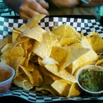 Chips with two types of salsa.