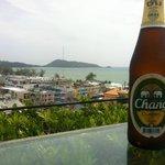 Enjoying a beer overlooking the ocean