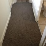 Heavily stained carpets in entrance